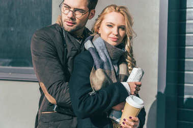 couple with coffee to go and map