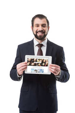 businessman showing tablet with photo stock
