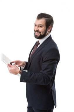cheerful businessman with tablet