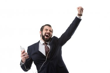 businessman listening music on smartphone