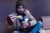 Fotografie homeless man eating canned food