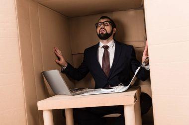 businessman with cardboard laptop