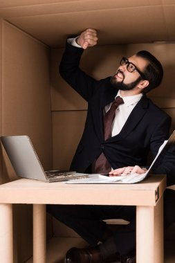 businessman working with cardboard laptop
