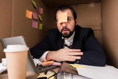 businessman with sticky note on forehead