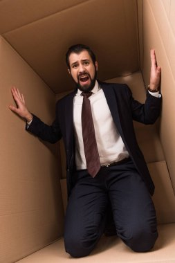 stressed businessman in box
