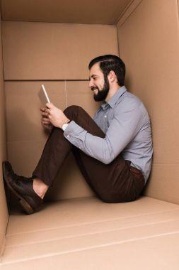 introvert using digital tablet