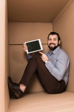 Man pointing at tablet with html code