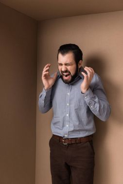 Stressed man yelling in cardboard box stock vector