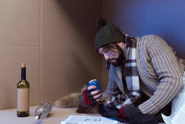 homeless man with alcohol drinks
