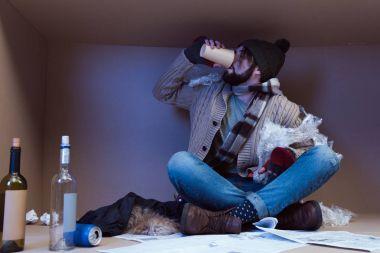 homeless man drunking alcohol