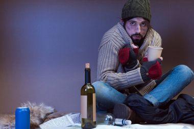 homeless man asking for alms
