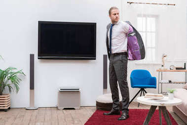 Businessman wearing jacket in the living room