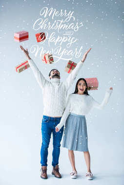 multicultural couple with wrapped christmas presents