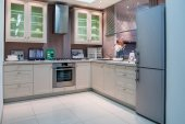 Photo modern kitchen interior with grey refrigerator