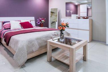 cozy modern bedroom interior in purple tones