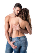 Fotografie Rückseite des sinnlichen halbnackten Paares, das sich isoliert auf Weiß umarmt