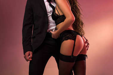 Cropped image of successful businessman with beautiful girl in lingerie stock vector