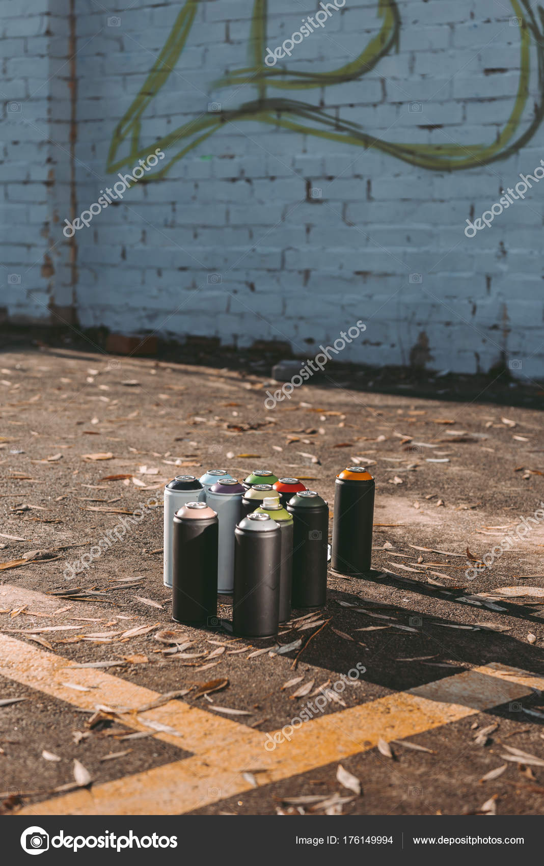 Cans With Colorful Spray Paint For Graffiti On Asphalt Photo By Vitalikradko
