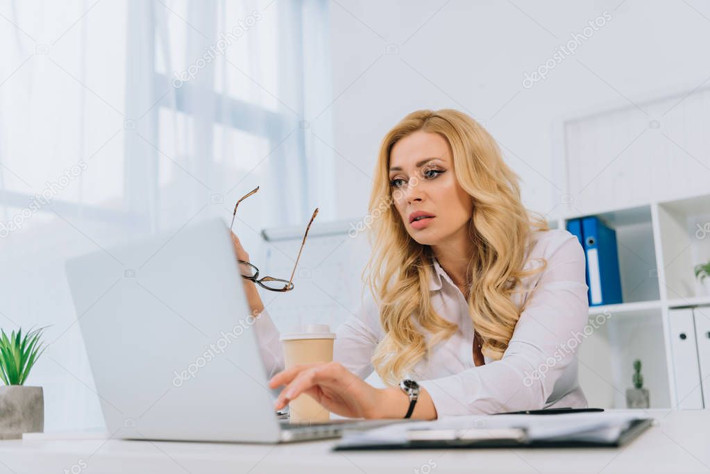 tired businesswoman working with laptop in office