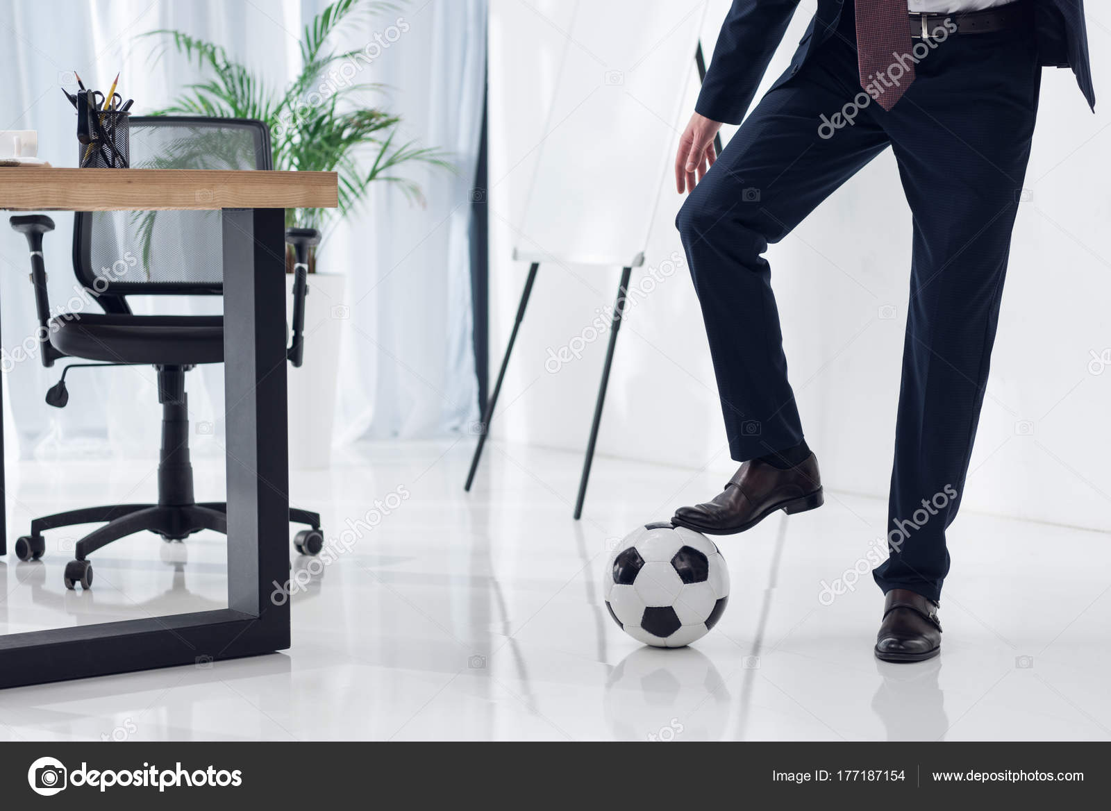 cropped shot businessman soccer ball workplace office stock photo