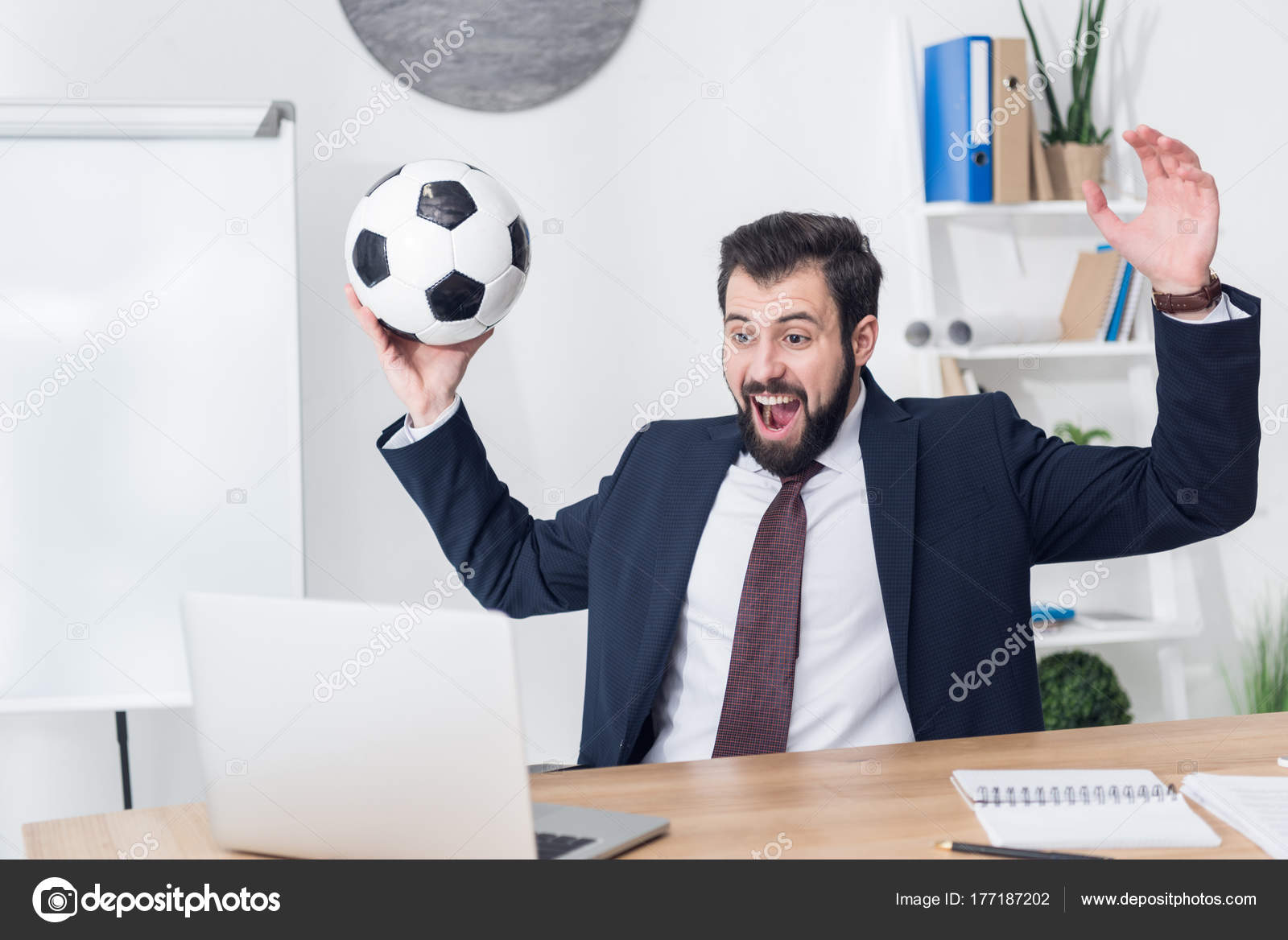 excited businessman suit soccer ball looking laptop screen workplace office stock photo