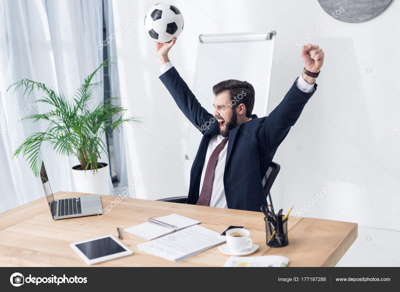 excited businessman suit soccer ball workplace office stock photo
