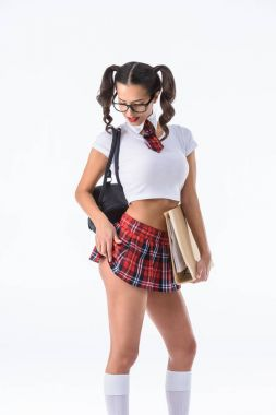 sexy schoolgirl in red plaid skirt with backpack and folder isolated on white