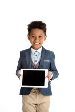 smiling african american kid showing tablet isolated on white