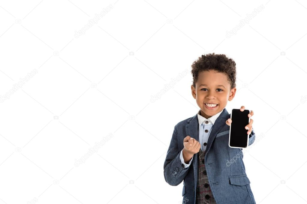 smiling african american kid showing smartphone isolated on white