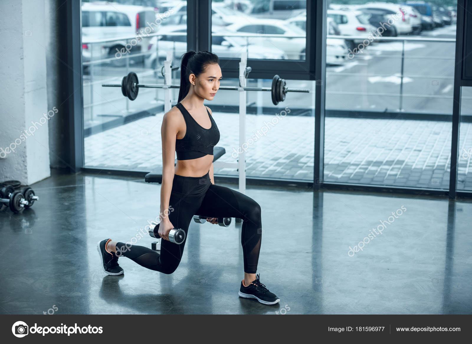 Young Sporty Woman Doing Single Leg Squats Dumbbells Gym