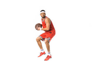 young sportsman playing basketball isolated on white