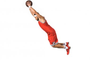 side view of young basketball player with ball jumping isolated on white