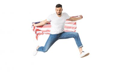 Handsome young man holding american flag and jumping isolated on white stock vector