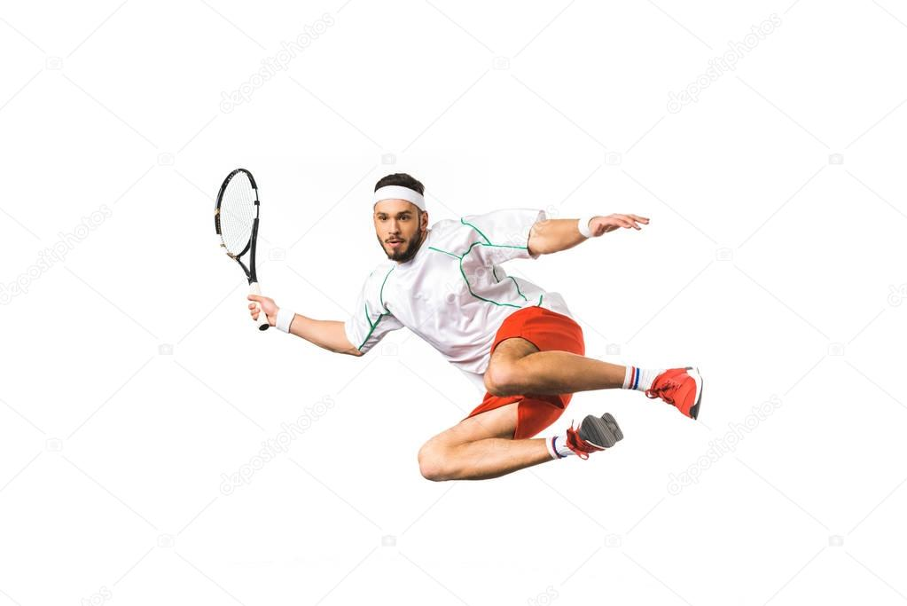 young sportsman playing tennis in jump isolated on white