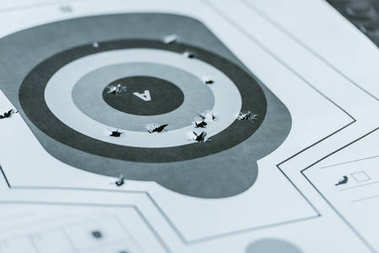 Used gun target with holes after bullets in shooting range stock vector