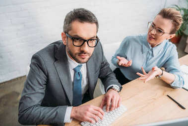 business colleagues working with computer together at modern office