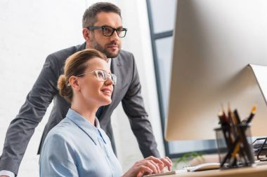 business partners working with computer together at office