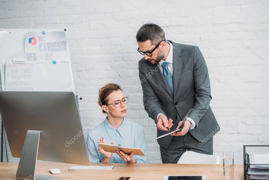 businesspeople wotking together at modern office