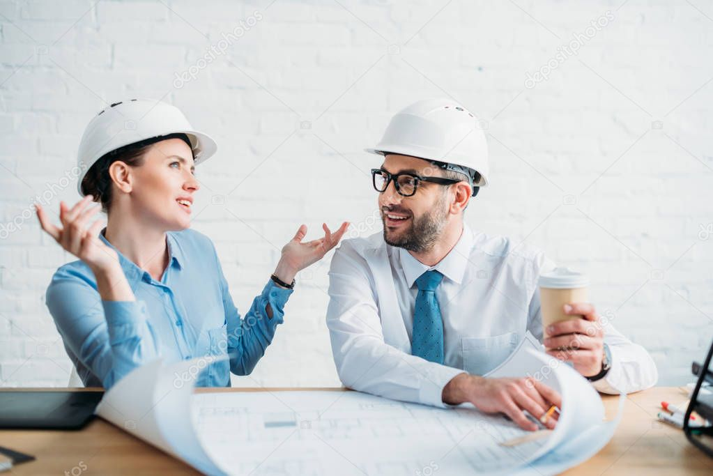experienced architects working with building plan at office