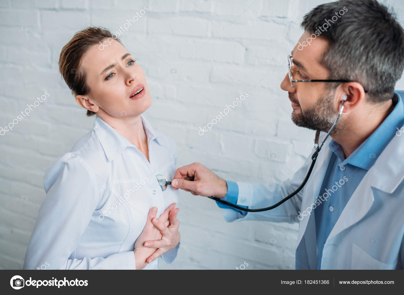 Listening to adult female heart beat with stethoscope