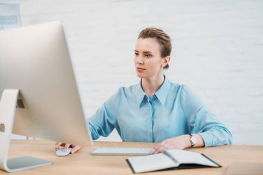 adult businesswoman working with computer at modern office