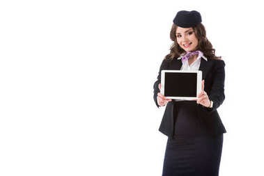 smiling stewardess showing tablet with blank screen isolated on white