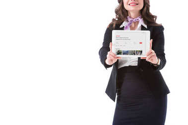 cropped image of stewardess holding tablet with airbnb website isolated on white