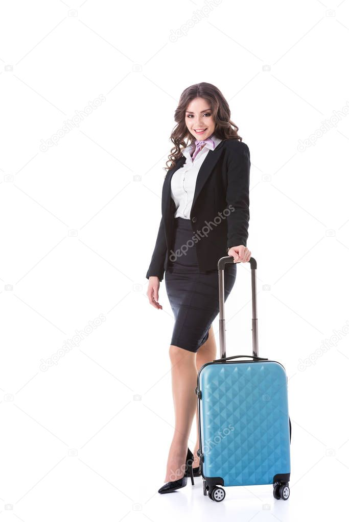 attractive stewardess with wheeled bag isolated on white
