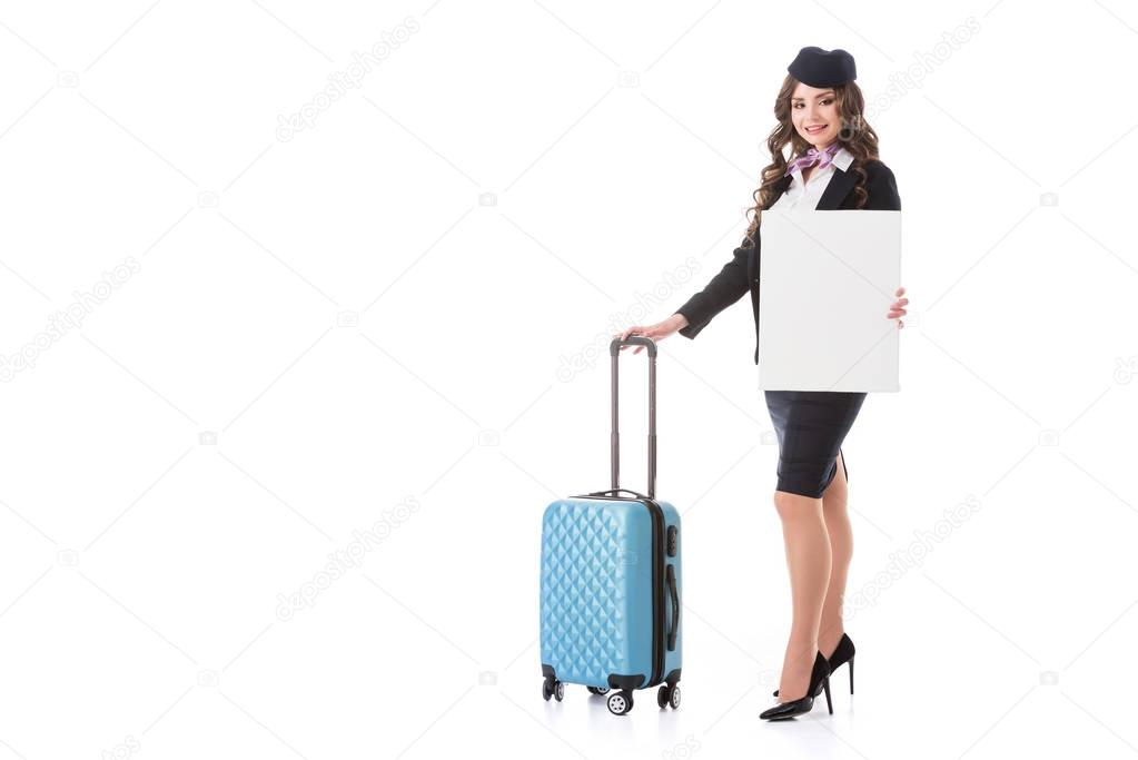beautiful stewardess with suitcase and empty board isolated on white