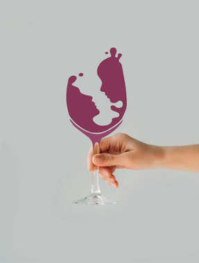 Cropped image of woman holding wine glass with couple silhouette isolated on gray