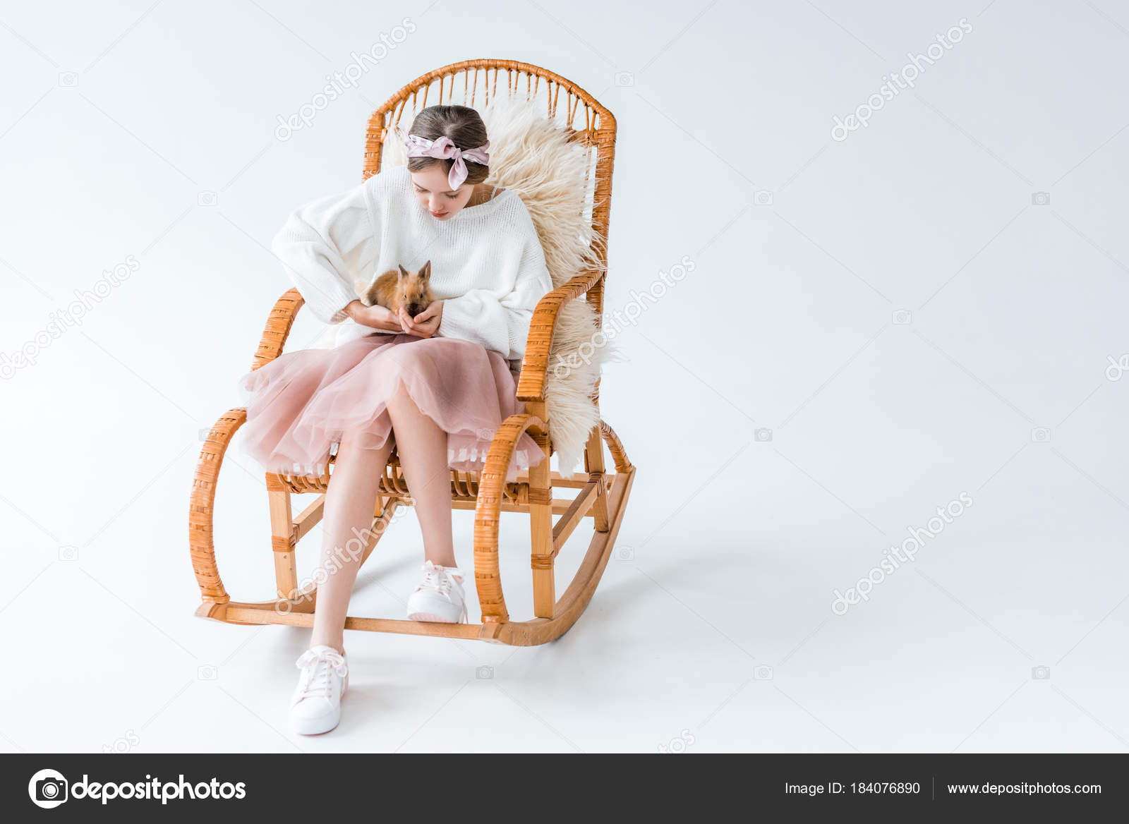 Adorable Girl Holding Furry Rabbit While Sitting On Rocking Chair Isolated White Photo By Vitalikradko