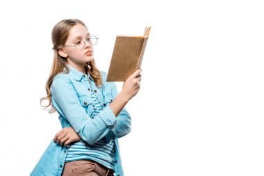 beautiful teenage girl in eyeglasses reading book isolated on white