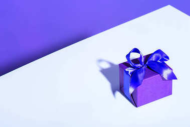 purple gift box with bow for birthday