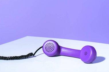 plastic purple telephone handset, ultra violet trend